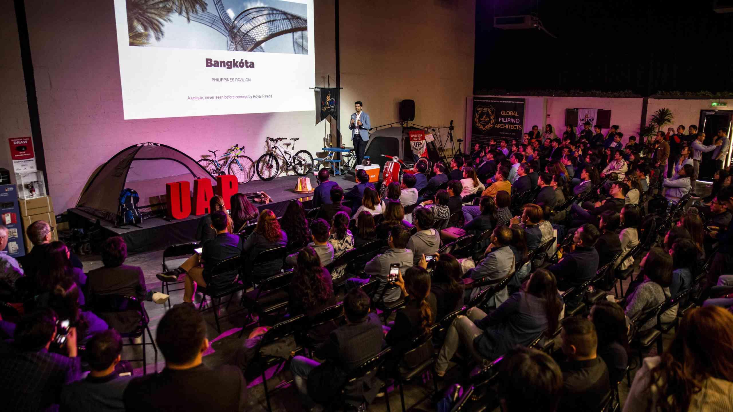 United Architects of Philippines Event at Warehouse Four, Al Quoz, Dubai, United Arab Emirates - Mustafa Kandori on stage presenting the opening arguments